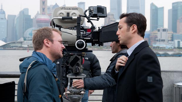 Rian Johnson with Joseph Gordon Levitt on set.