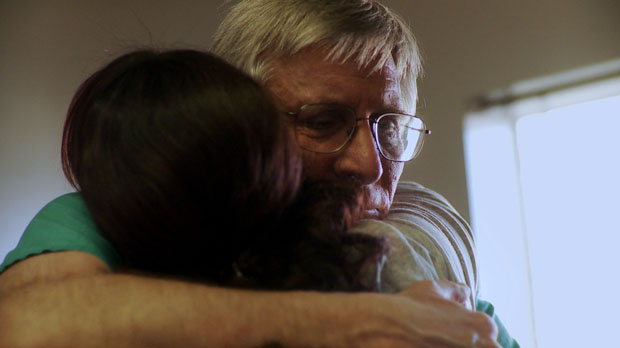 Dr. Warren Hern hugs a patient in After Tiller