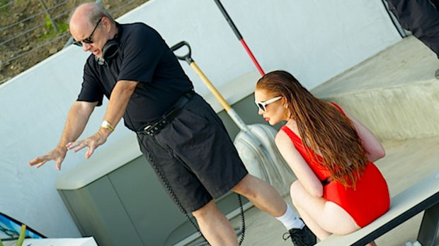Director Paul Schrader with Lindsay Lohan on the set of The Canyons