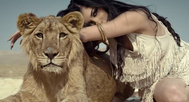 "Helly Luv in the music video for her hit Kurdish independence song, ""Risk It All."""