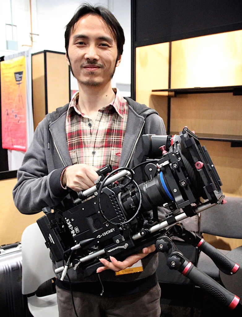 Cheng Zhang, chief technical officer of Beijing-based Kinefinity, with last year's version of KiniMINI 4K at NAB 2014.