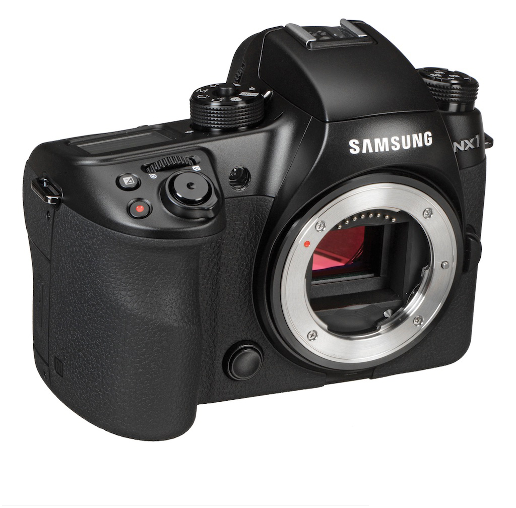 Samsung NX1. APS-C sensor like the Canon 7D but mirrorless. Note the red record button next to the shutter release.